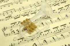 Trumpet on sheet music Stock Photo
