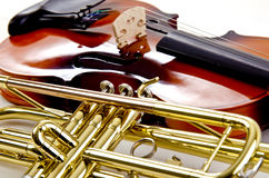 Trumpet and shiny violin close up. Close up  of a shiny trumpet and a violin on white Stock Photos