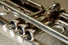Trumpet valves. Of a sylver trumpet lying down Stock Photos