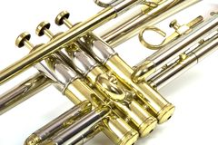 Trumpet Valves. Isolated photograph of the middle section (valves) of a silver and brass trumpet royalty free stock photo