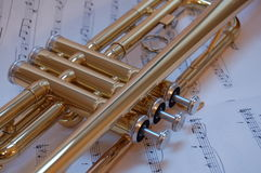 Trumpet Valves. Close up of trumpet valves with music background Royalty Free Stock Photography