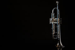 Trumpet, wind instrument. Lonely musical instrument which is a trumpet on a black background Stock Photography