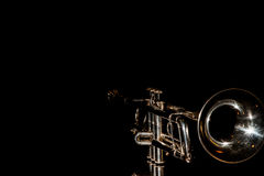 Trumpet, wind instrument. Lonely musical instrument which is a trumpet on a black background Royalty Free Stock Photography