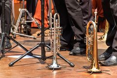 Trumpet on a wooden stage. Trumpet standing on the floor. Presentation of the brass band. Trumpet on a wooden stage. Trumpet standing on the floor. Presentation stock photos