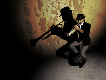 Trumpeter. A musician trumpeter playing his instrument, sat on a bench next to a ruined wall Royalty Free Stock Image