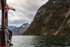 Trumpeter on a boat in Berchtesgaden Royalty Free Stock Photo