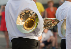Trumpeter with French horn waits start of parade Royalty Free Stock Photos