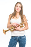 Trumpeter girl in jeans and shirt with his trumpet on white Royalty Free Stock Photo
