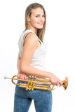 Trumpeter girl in jeans and shirt with his trumpet on white Stock Photo