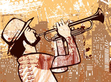 Trumpeter on a grunge backgrounf Stock Image