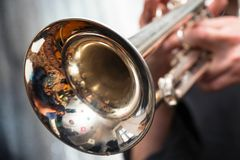 Trumpeter is playing on a silver trumpet Stock Photos