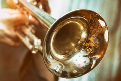 Trumpeter is playing on a silver trumpet. The trumpeter is playing on a silver trumpet. Trumpet player Royalty Free Stock Photography