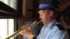 The trumpeter  plays every hour - Krakow - Poland. Krakow, Poland - August 8, 2017: The trumpeter  plays every hour, from the highest tower in the city. The stock video