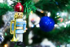 Trumpeter on a spruce branch in the new year. Background Stock Photography