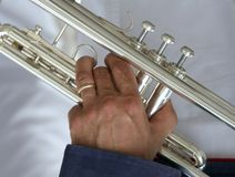 Trumpeter with the trumpet in hand. Trumpeter with the trumpet in his hand Royalty Free Stock Photos