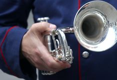 Trumpeter with the trumpet in hand. Trumpeter with the trumpet in his hand Stock Photos