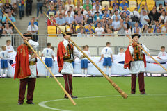 Trumpeters dressed in national costumes before the match Royalty Free Stock Photo