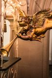 A trumpeting golden music angel statue detail on a german christmas market stock images