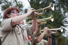 Trumpets play Taps at 2014 Memorial Day Event, Los Angeles National Cemetery, California, USA Royalty Free Stock Photo
