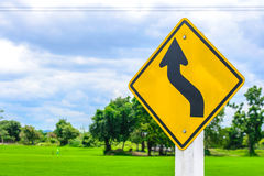 Trun left with field , traffic sign Royalty Free Stock Photos