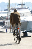 Trundling Along. Cyclist on the Quay Royalty Free Stock Images