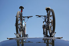 Trunk of the car with two bikes. Closeup two bikes on the trunk of a car Stock Images