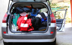 Trunk of the car very overloaded with bags and luggage Royalty Free Stock Photo