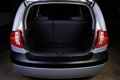 Trunk of hatchback on black stock photos