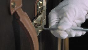 Trunk Maker at work in his workshop. Installation by screwing the brass closures stock footage