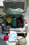 Trunk overloaded with  bags for vacation with a fishing net Stock Images