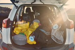 Trunk with stuff for camping. Trunk of a car loaded with travel camping equipment in Iceland royalty free stock photos