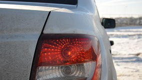 Trunk and tail light of a dirty car stock footage