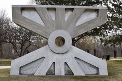 Trunnion II. This is an early Spring picture of a piece of public art titled: Trunnion II, on display at the Skokie Northshore Sculpture Park located in Skokie Stock Photo