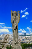 Trupet angel. An angel plays the trumpet on the roof of the Cathedral of Notre Dame in Paris Stock Photo