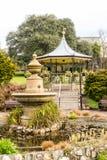 Truro Victoria Gardens. England, Truro - 06 March 2016: Truro Victoria Gardens Fountain and bandstand in background vertical photography Royalty Free Stock Image