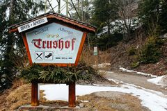 Trushof, Italy - 03 20 2013: the sign for the hotel in the Alpine village, winter landscape stock image