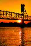 Truss Bridge with Lift Span over River at Sunset stock photo