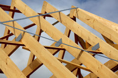 Truss framework. A new build roof with a wooden truss framework stock photo