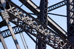 Trusses And Beams From A Bridge. A gray pattern of steel for a bridge on a blue background Stock Images
