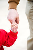 Trust. Baby reaching up to hold on to father's finger royalty free stock photo