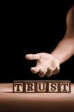 Trust. Hand gesture, offering trust concept on dark background Stock Photo