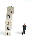 Trust. A businessman standing alongside the word trust Stock Photos
