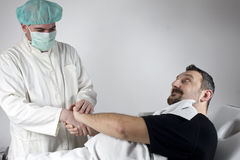 Trust. Doctor and his patient shaking hands Stock Photo