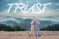 Trust against scenic countryside with mountains Royalty Free Stock Image