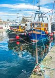 Trust at Burghead Harbour. Trust and Kalisto, fishing boats tied up at Burghead Harbor on the North East coast of Scotland stock photo