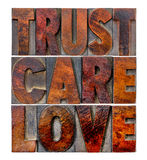 Trust, care, love in wood type Stock Image
