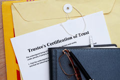 Trust certificate. Abstract- with diary and manila envelop Stock Images
