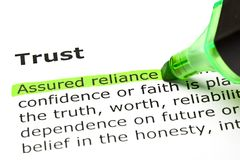 Trust Dictionary Definition Green Text Marker. Assured reliance highlighted in green, under the heading Trust in dictionary definition Royalty Free Stock Photo