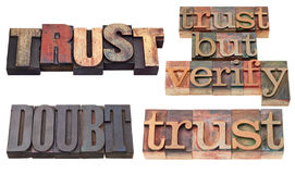 Trust and doubt  in letterpress type Stock Photos