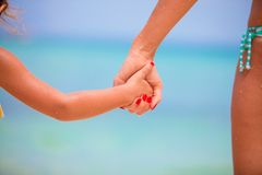 Trust family hands of child girl and mother on Royalty Free Stock Images